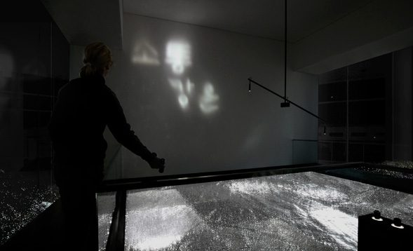Viewers can discover the sculpture's hidden meanings with the help of light that is reflected by the wavy mirror forming different words on the wall.