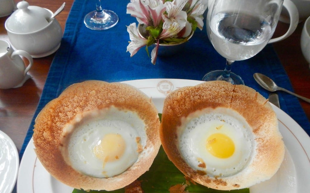 Hoppers is a crispy bowl-shaped pancake made from rice flour and is sometimes topped with an egg. Photo credit: Flickr | Royston Rascals