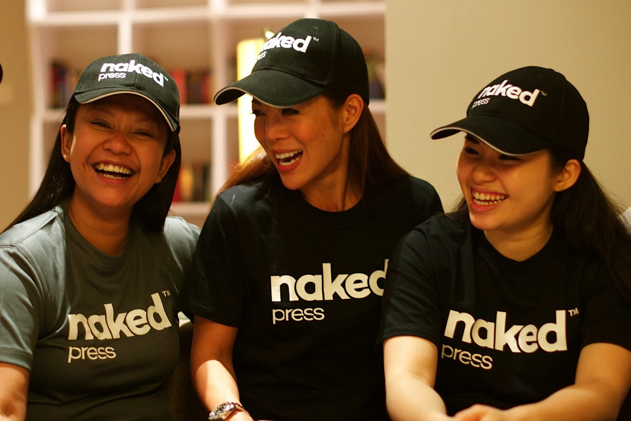 Stacey H. (middle) & Dewi K. (right), founders of Naked Press, with their assistant (left)